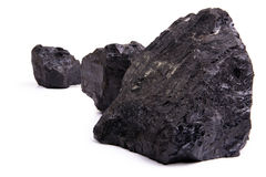 Lumps of Coal. Chunks of coal isolated on a white background Stock Photography