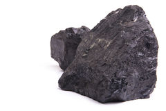 Lumps of Coal. Chunks of coal isolated on a white background Stock Photos