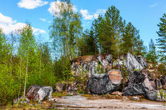 Lumps of rock of white marble in Ruskeala Park Royalty Free Stock Photo