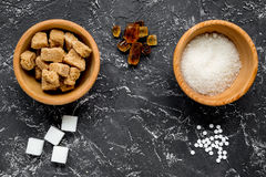 Lumps and sanding sugar for sweets on kitchen table background top view Royalty Free Stock Photography