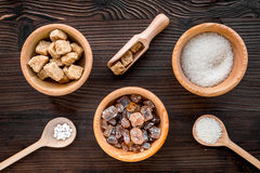 Lumps and sanding sugar for sweets on wooden kitchen table background top view Stock Images
