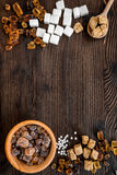 Lumps and sanding sugar for sweets on wooden kitchen table background top view mock up Stock Image