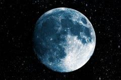 Luna azul estupenda en el fondo de la galaxia Foto de archivo