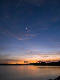 Luna crescent sobre el lago Fotografía de archivo libre de regalías