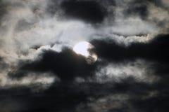 Luna detrás de las nubes Foto de archivo libre de regalías