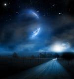 Luna di fantasia sopra il paesaggio Fotografia Stock Libera da Diritti