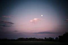 Luna diurna sobre la granja Foto de archivo libre de regalías