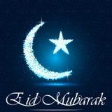 Luna e stella crescenti brillanti su fondo nero e blu per il mese santo di Ramadan Kareem Fotografie Stock
