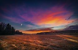 Luna en la puesta del sol Foto de archivo libre de regalías