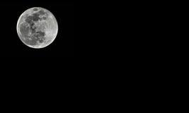 Luna Llena detallada en fondo negro Imagenes de archivo