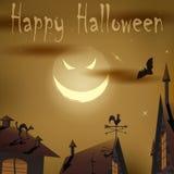 Luna malvada de la noche de Halloween sobre casas Fotos de archivo libres de regalías