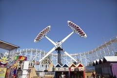 Luna Park Amusement Park Ride - Melbourne. Melbourne, Australia: March 18, 2017: Tourists enjoy the ride at the funfair in Melbourne`s Luna Park. The historic Stock Images