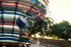 Luna Park, carrusel del oscilación Foto de archivo