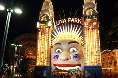 Luna Park with Ferris wheel blur at night. Luna Park Sydney Entrance (Australia), illuminated at night - with the blurred illustration of a spinning Stock Photography