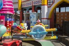 Luna Park - Melbourne. St Kilda, Melbourne, Australia: March 18, 2017: A little boy rides a carousel at Melbourne`s Luna Park. The historic amusement park is Stock Photo