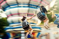 Luna park, schommelingscarrousel Stock Fotografie