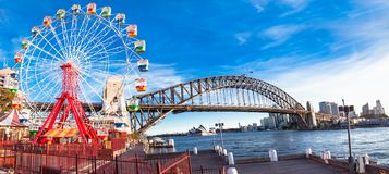 Luna park wheel with harbour bridge arch in Sydney, Australia. Luna park wheel with harbour bridge arch at sunset in Sydney, Australia Royalty Free Stock Photo
