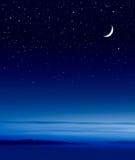 Luna sopra l'oceano Fotografia Stock