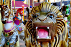 Lunapark Horses and Lion. A deatail from a lunapark Royalty Free Stock Photography