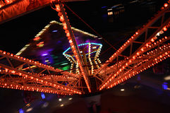 Lunapark at night with many lights. Photographed in motion from the carousel Stock Photography
