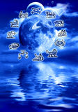 Lunar astrology. Composite of moon and planets over water with all the astrological symbols around it stock illustration