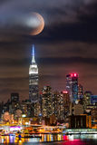 Lunar eclipse above New York Royalty Free Stock Image