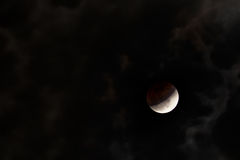 Lunar eclipse with clouds Royalty Free Stock Photo