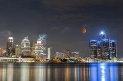 Lunar eclipse and detroit skyline. Lunar eclipse last October 8 over skyline of detroit michigan royalty free stock photo