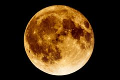 Lunar eclipse - Full Moon Luna. Earth`s permanent natural satellite - the Moon during a Lunar eclipse - umbra. A lunar eclipse occurs when the Moon passes Stock Photo