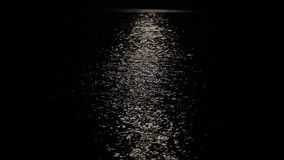 A lunar path is in a nightly sea stock video footage