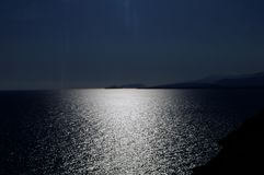 Moonrise over the quiet sea. Night time royalty free stock photography
