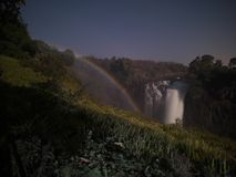 Lunar rainbow in Victoria Falls from Zimbabwe side. Victoria Falls, Zimbabwe-August 17, 2016:The lunar rainbow in Victoria Falls is an amazing sight, when the Stock Image