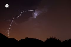 Lunar Strike. Lightning in Central Florida with moon Stock Photos