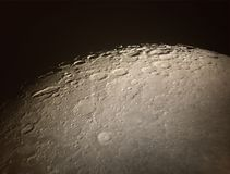 Lunar surface and craters. As seen through a telescope Royalty Free Stock Image