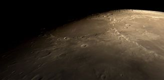 Flying over the lunar surface. Lunar surface and craters as seen through a virtual spaceship Royalty Free Stock Photo