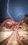 Lunar Valley in the Atacama Desert. Chile. Powerful lightning strike. Powerful lightning strike Stock Photos