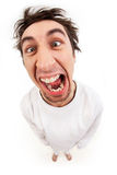 Lunatic. Fish eye shot of screaming insane man in strait-jacket in isolation Royalty Free Stock Image