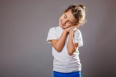 Lunatic girl sleeps standing hand under his cheek Stock Images