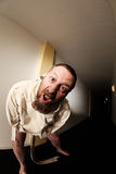 Lunatic in a straitjacket Stock Photo