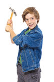 Lunatic teenage boy holding a hammer ready to hit, isolated on w Stock Photos