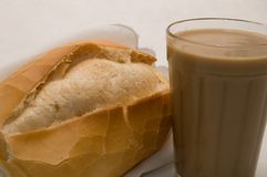 Lunch. Breakfast, bread with milk and coffee royalty free stock photo