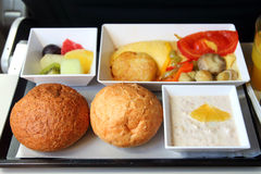 Lunch in airplane. Seafood meal stock photos