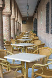 Lunch in ancient exotic location. Restaurant terrace in the courtyard of an old castle with brick walls Royalty Free Stock Image