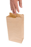 Lunch bag. A man reaches into his lunch sack to grab his food Royalty Free Stock Image