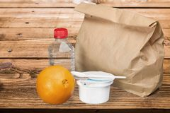 Lunch. Bag brown packed  water food  break Royalty Free Stock Images