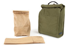 Lunch bags. Disposable paper lunch bags or reusable fabric sack royalty free stock photography