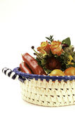 Lunch basket. Basket with flowers and food Royalty Free Stock Images