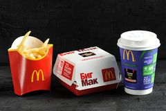 Lunch with bigMac from McDonald`s monopoly promotion stock photography
