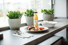 Lunch in bistro. Lunch salad soup and orange juice royalty free stock images