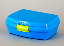 Lunch box. A blue lunch box on white background Royalty Free Stock Photography